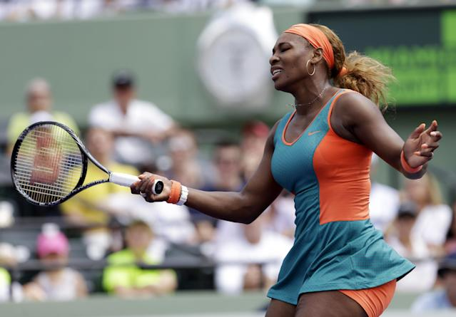 Serena Williams reacts after losing a point to Maria Sharapova, of Russia, at the Sony Open Tennis tournament in Key Biscayne, Fla., Thursday, March 27, 2014. (AP Photo/Alan Diaz)