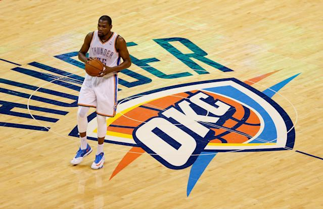 Kevin Durant of the Oklahoma City Thunder brings the ball up court against the San Antonio Spurs in the first half during Game Four of the Western Conference Finals of the 2014 NBA Playoffs at Chesapeake Energy Arena on May 27, 2014 in Oklahoma City (AFP Photo/Joe Robbins)