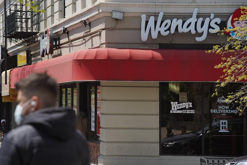 NEW YORK, NEW YORK - MAY 10: A person walks by a Wendy's restaurant in Washington Heights on May 10, 2020 in New York City. COVID-19 has spread to most countries around the world, claiming over 282,000 lives with infections of over 4.1 million people. (Photo by Rob Kim/Getty Images)