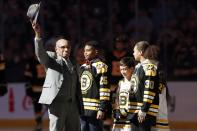 Hockey Hall of Famer Willie O'Ree, right, waves to the crowd before dropping the ceremonial puck before an NHL hockey game between the Boston Bruins and the Edmonton Oilers in Boston, Saturday, Jan. 4, 2020. (AP Photo/Michael Dwyer)