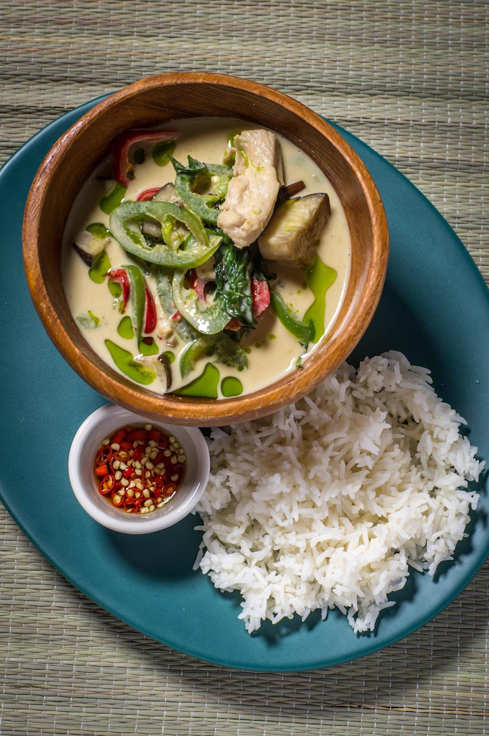 """This fragrant green curry with chicken and eggplant comes from Chef Hong Thaimee, author of <a href=""""https://www.amazon.com/True-Thai-Flavors-Every-Table/dp/0847846237"""" rel=""""nofollow noopener"""" target=""""_blank"""" data-ylk=""""slk:True Thai"""" class=""""link rapid-noclick-resp""""><em>True Thai</em></a>. <a href=""""https://www.epicurious.com/recipes/food/views/thai-green-curry-chicken-gaeng-khiaw-wan-gai?mbid=synd_yahoo_rss"""" rel=""""nofollow noopener"""" target=""""_blank"""" data-ylk=""""slk:See recipe."""" class=""""link rapid-noclick-resp"""">See recipe.</a>"""