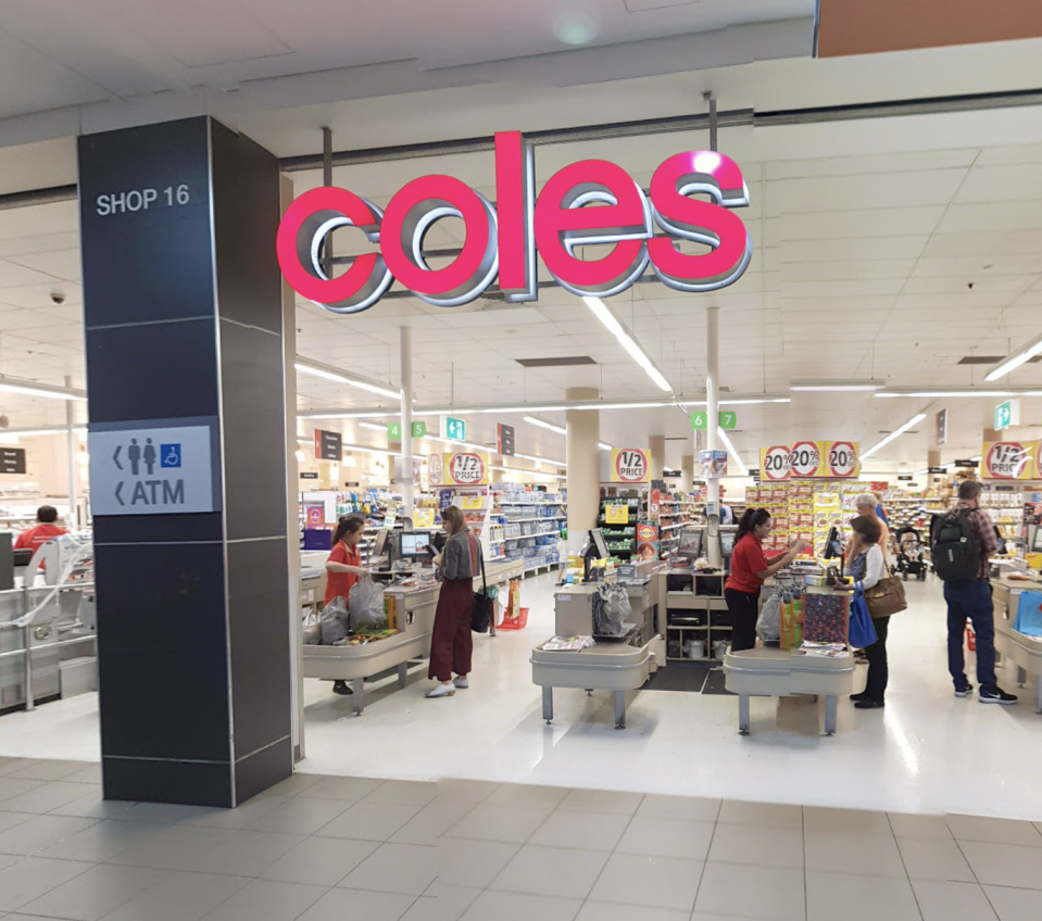 Photo shows the front of a Coles store.
