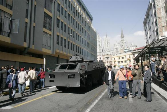An anti-riot armored police vehicle patrols a street near the Ecuador Congress building as supporters of 57 fired congressmen and supporters of the sacking rally, in Quito March 13, 2007.