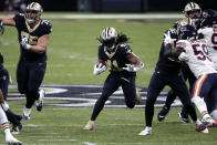 New Orleans Saints running back Alvin Kamara (41) carries in the first half of an NFL wild-card playoff football game against the Chicago Bears in New Orleans, Sunday, Jan. 10, 2021. (AP Photo/Butch Dill)