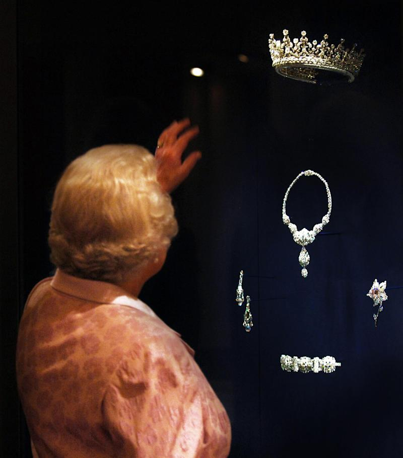 <strong>Queen Elizabeth II shown in 2007 looking at the Queen Mary Diamond Tiara given to her as a wedding present by her grandmother Queen Mary, who herself received it as a wedding gift</strong> (PA Archive/PA Images)