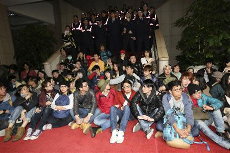 Students protest inside Taiwan's Executive Yuan in Taipei