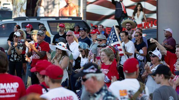 PHOTO: People listen to the speaker at a rally against restrictions to prevent the spread of coronavirus in Phoenix, July 4, 2020. (Cheney Orr/Reuters)
