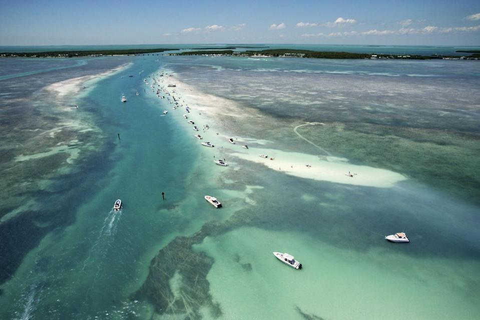 """<p>Feel worlds away without a passport with a New Year's getaway to the Florida Keys. This stretch of barrier islands is ideal for those looking for socially distanced options in South Florida. Find a true boater's paradise in <a href=""""https://www.marlinbay.com/"""" rel=""""nofollow noopener"""" target=""""_blank"""" data-ylk=""""slk:Marlin Bay Resort & Marina"""" class=""""link rapid-noclick-resp"""">Marlin Bay Resort & Marina</a>, which features 13 luxury vacation homes on the property, each boasting their own plunge pool. Grab your favorite couple or a few of your dearest friends and spend the long weekend exploring the Atlantic. </p>"""