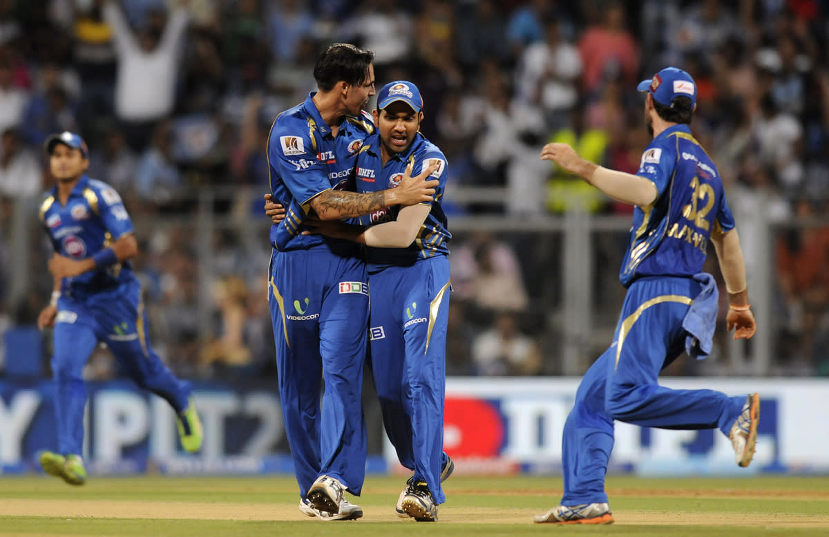 Mitchell Johnson of Mumbai Indians celebrates the wicket of Rahul Dravid captain of Rajasthan Royals during match 66 of the Pepsi Indian Premier League ( IPL) 2013  between The Mumbai Indians and the Rajasthan Royals held at the Wankhede Stadium in Mumbai on the 15th May 2013 ..Photo by Pal Pillai-IPL-SPORTZPICS ..Use of this image is subject to the terms and conditions as outlined by the BCCI. These terms can be found by following this link:..https://ec.yimg.com/ec?url=http%3a%2f%2fwww.sportzpics.co.za%2fimage%2fI0000SoRagM2cIEc&t=1490815753&sig=eHG1e6IbPOX.HpfAZCyJMQ--~C