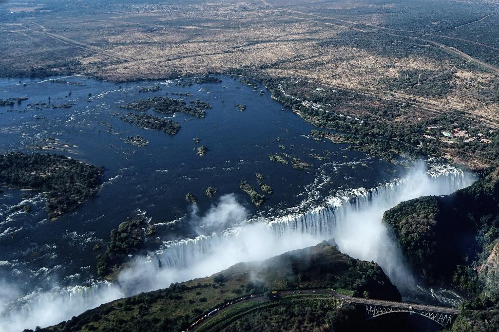 An aerial view of the Victoria Falls on the Zambezi River at the border between Zambia and Zimbabwe. Tourism accounts for around 10 percent of Zimbabwe's GDP. (AFP Photo/Zinyange AUNTONY)