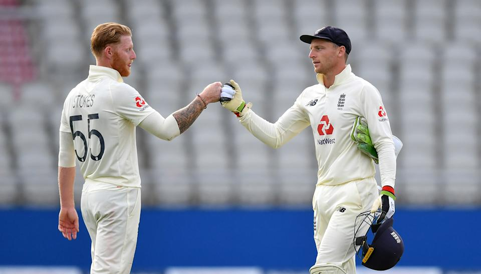 Jos Buttler (pictured right) and Ben Stokes (pictured left) fist-bump during a Test match.