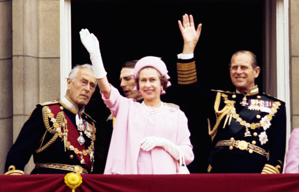 The Queen and Prince Philip waving to the crowds during her Silver Jubilee celebrations in 1977. The jubilee marked her 25th anniversary from acceding to the throne, and included a tour of countries around the world.