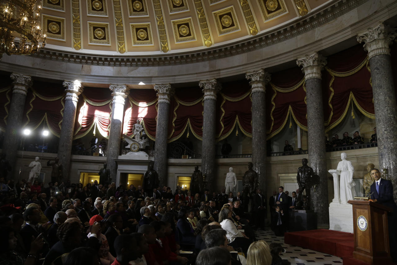 President Barack Obama speaks in the Capitol Rotunda on Capitol Hill in Washington, Wednesday, Feb. 27, 2013, during the unveiling of a statue of Rosa Parks, second from left. (AP Photo/Charles Dharapak)