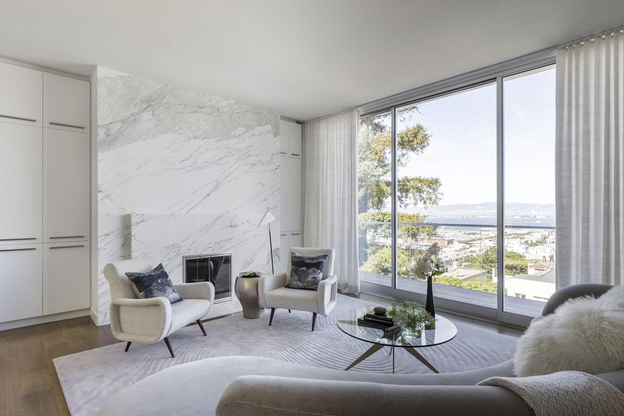 """<p>For a serene San Francisco home, <a rel=""""nofollow"""" href=""""https://deringhall.com/architects/jennifer-tulley-architects"""">Jennifer Tulley Architects</a> used a marble accent wall to craft a calm, luxurious environment. The interiors are by Niche Interiors, and the millwork is by Cugini Cabinets.</p>"""