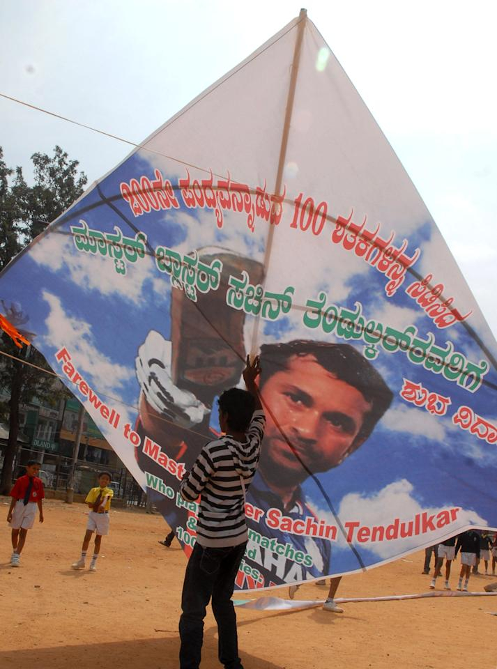A Child flies a gigantic kite with an image of Sachin Tendulkar ahead of his 200th and last match, in Bangalore on Nov.13, 2013. (Photo: IANS)
