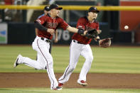 Arizona Diamondbacks shortstop Nick Ahmed, left, and second baseman Wilmer Flores vie for the ball against the San Diego Padres during the second inning of a baseball game Sunday, Sept. 29, 2019, in Phoenix. (AP Photo/Darryl Webb)