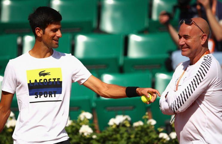 Serbian star Novak Djokovic works with new coach Andre Agassi before Day 4 of the French Open. (Getty Images)