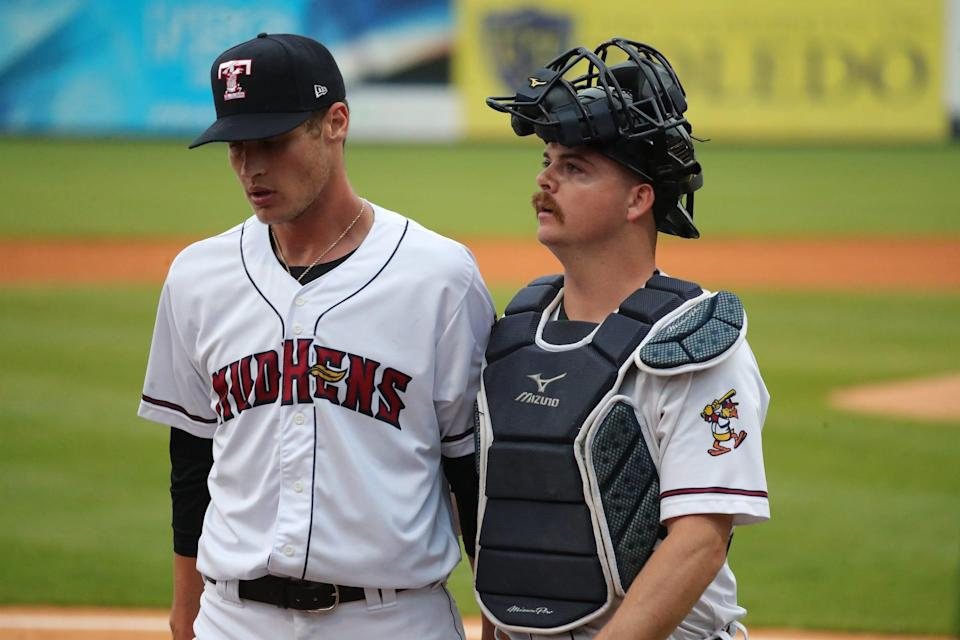 Toledo Mud Hens pitcher Matt Manning, a top Detroit Tigers prospect, and catcher Jake Rogers walk off the field Tuesday May, 4, 2021, during action against the Nashville Sounds in Toledo, Ohio.