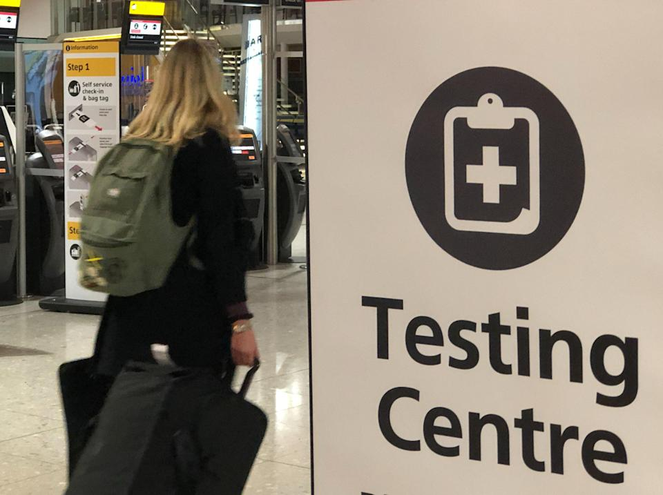 Testing times: a traveller at Heathrow  Terminal 2 (Simon Calder)
