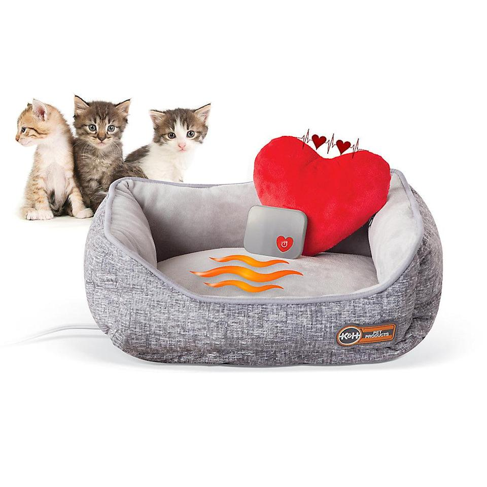 """<p>Even when you can't hug your cat, they will be able to feel your warm embrace with this heated bed. </p> <p><strong>Buy it!</strong> K&H Mother's Heartbeat Heated Kitty Pet Bed, $58.99; <a href=""""https://petsmart.haujjd.net/c/249354/764629/11083?subId1=PEO10AdorableGiftstoGetYourLovingPetforValentinesDaykbender1271PetGal12571843202102I&u=https%3A%2F%2Fwww.petsmart.com%2Ffeatured-shops%2Fvalentines-day%2Fkandh-mothers-heartbeat-heated-kitty-pet-bed-with-heart-pillow-62857.html%3Fcgid%3D5000125"""" rel=""""nofollow noopener"""" target=""""_blank"""" data-ylk=""""slk:PetSmart.com"""" class=""""link rapid-noclick-resp"""">PetSmart.com</a></p>"""