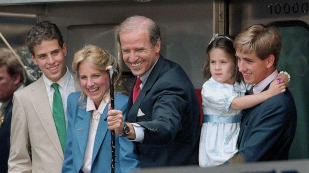 PHOTO: Jill Biden smiles as Sen. Joseph Biden of Delaware grabs a walking stick presented him for the campaign by a supporter as he leaves aboard a train for with their children Washington in Wilmington, Del., June 9, 1987. (Bettmann Archive)