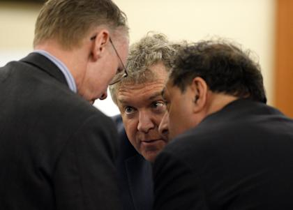 Aaron Hernandez's attorneys huddle during the murder trial. (AP)