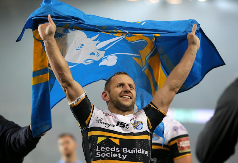Leeds Rhinos' Rob Burrow celebrates with a flag after the final whistle during the Betfred Super League Grand Final at Old Trafford, Manchester.