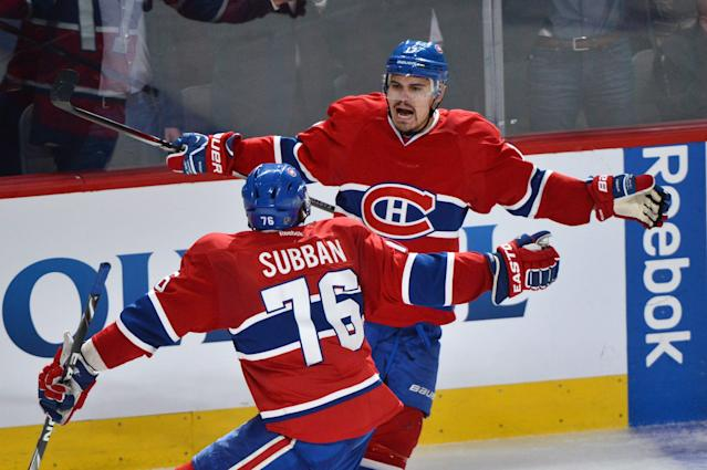 Montreal Canadiens' Rene Bourque, rear, celebrates with teammate P.K. Subban after scoring against the New York Rangers during the third period of Game 5 of the NHL hockey Stanley Cup playoffs Eastern Conference finals, Tuesday, May 27, 2014, in Montreal. (AP Photo/The Canadian Press, Paul Chiasson)