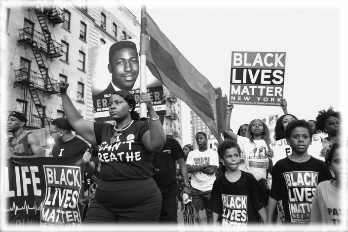 Black Lives Matter activists in New York in July in the wake of prosecutors' decision not to bring civil rights charges against New York City Police Officer Daniel Pantaleo in the 2014 chokehold death of Eric Garner. (Photo: Craig Ruttle/AP; digitally enhanced by Yahoo News)