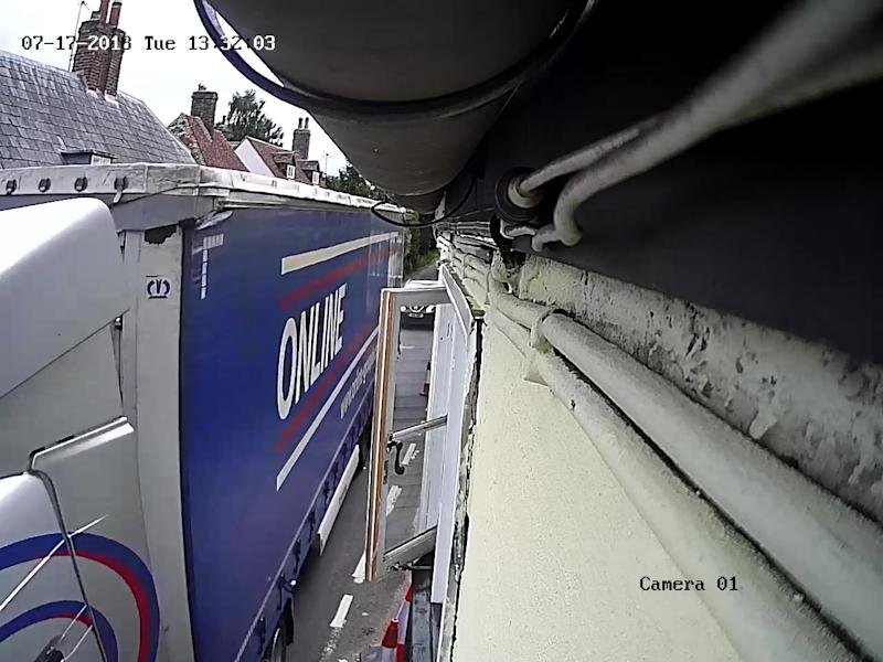 The lorry captured on CCTV. (SWNS)