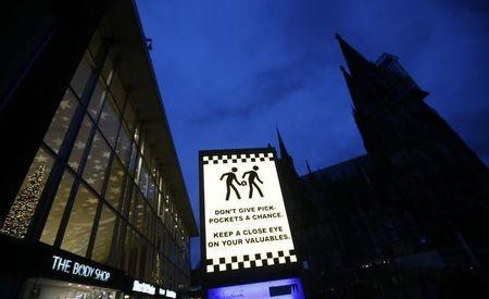 An electronic information sign warning the general public against pickpockets, is illuminated on an advertising board outside the main railway station and in front of Cologne Cathedral in Cologne, Germany, January 5, 2016. REUTERS/Wolfgang Rattay