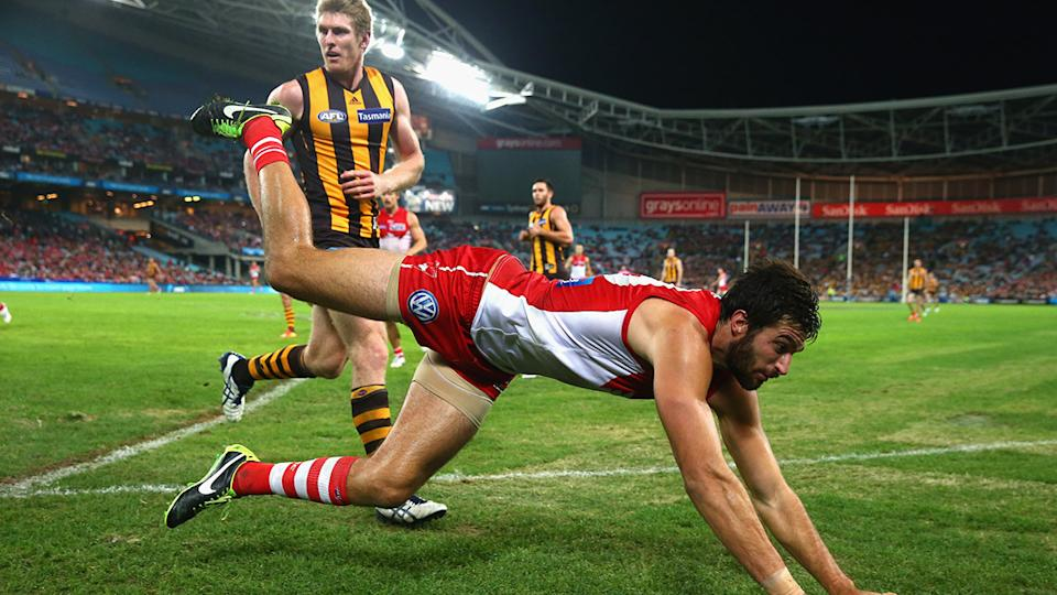 The Sydney Swans and Hawthorn Hawks, pictured here playing at ANZ Stadium in 2014.