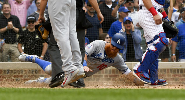 Los Angeles Dodgers' Justin Turner (10) scores during the ninth inning of a baseball game against the Chicago Cubs, Tuesday, June 19, 2018, in Chicago. (AP Photo/Matt Marton)