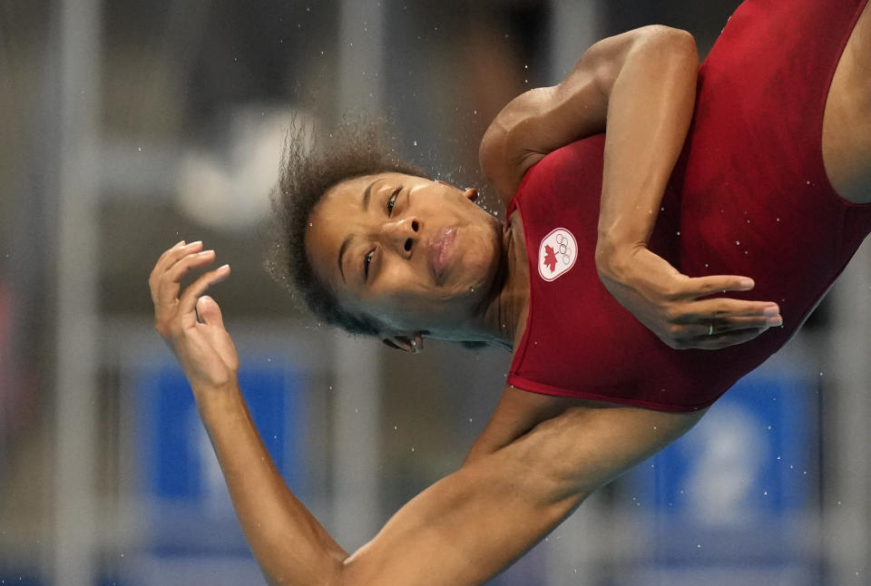 Jennifer Abel of Canada competes in women's diving 3m springboard semifinal at the Tokyo Aquatics Centre at the 2020 Summer Olympics, Saturday, July 31, 2021, in Tokyo, Japan. (AP Photo/Dmitri Lovetsky)