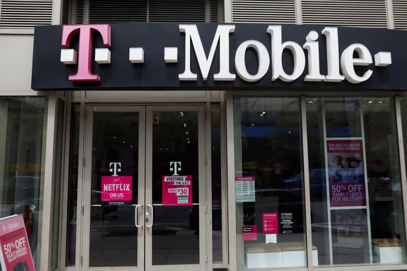A sign for a T-Mobile store is seen in Manhattan, New York