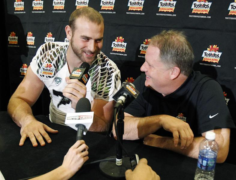 Oregon offensive lineman Kyle Long, left, interviews head coach Chip Kelly during media day for the Fiesta Bowl NCAA college football game, Monday, Dec. 31, 2012, in Scottsdale, Ariz. Oregon is scheduled to play Kansas State on Jan. 3, 2013, in Glendale. (AP Photo/Paul Connors)