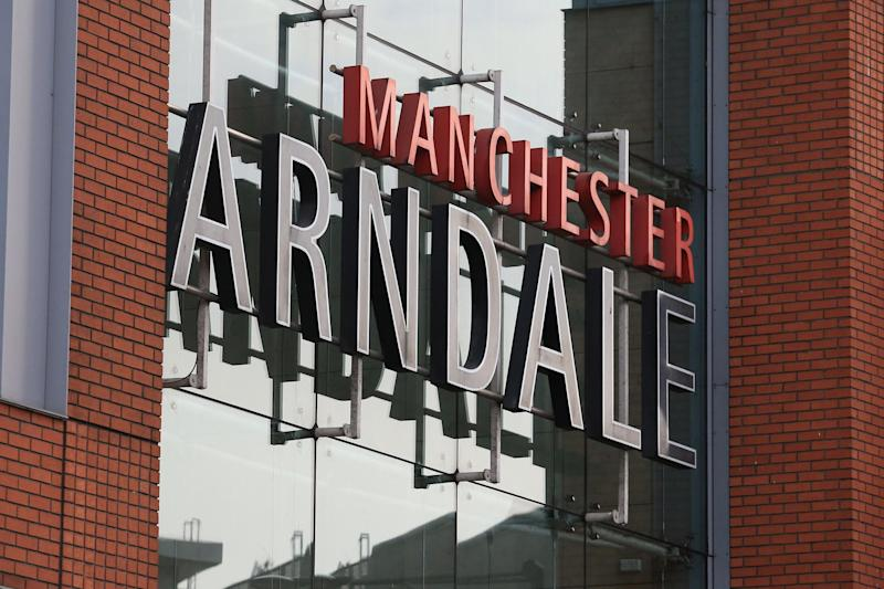 A sign is pictured outside a cordoned off Arndale Centre shopping complex in Manchester, northwest England on October 11, 2019: AFP via Getty Images