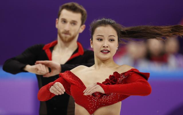 <p>Yura Min and Alexander Gamelin of South Korea compete. REUTERS/John Sibley </p>