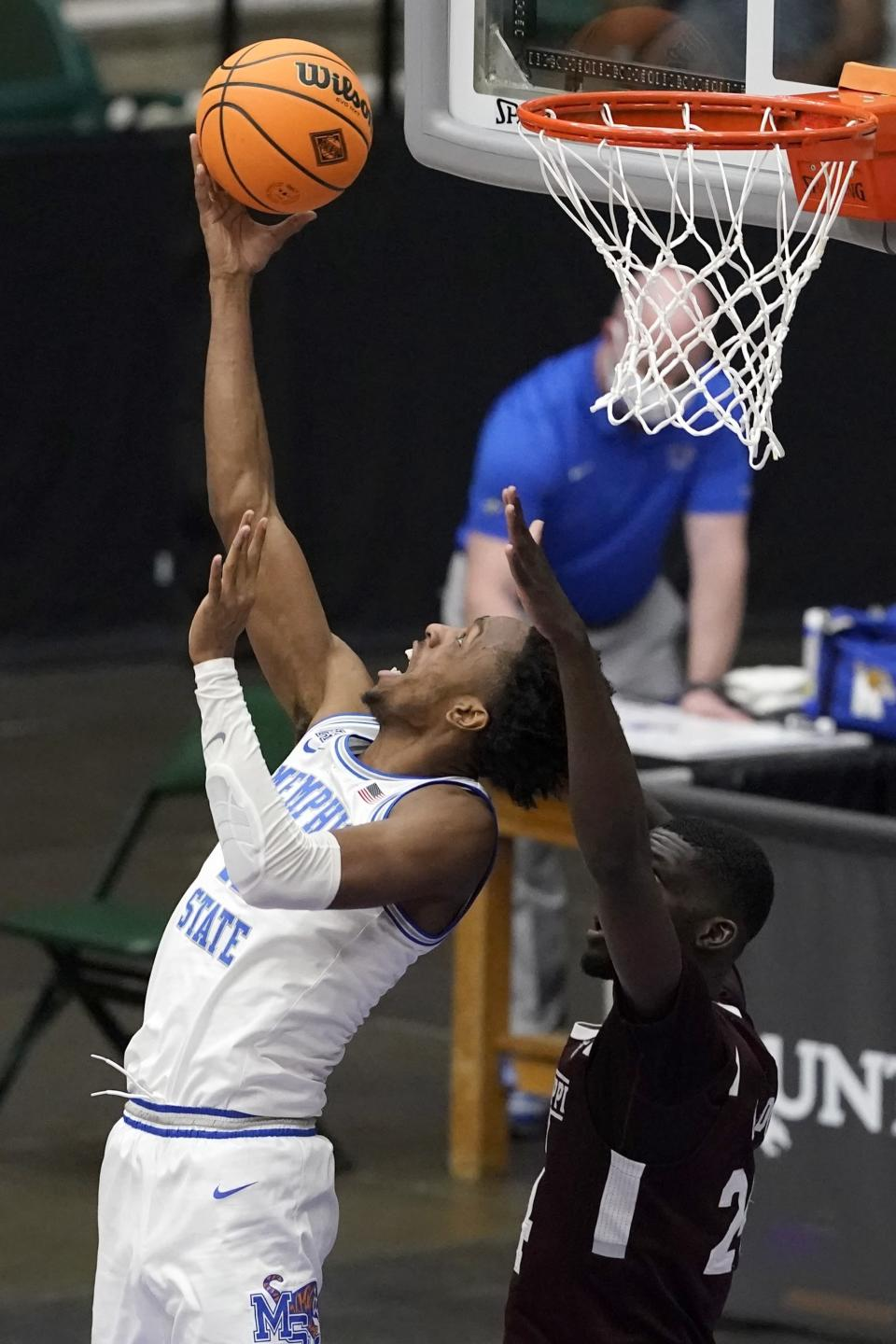 Memphis forward DeAndre Williams, left, throws up a shot as Mississippi State forward Abdul Ado, right, defends in the second half of an NCAA college basketball championship game in the NIT, Sunday, March 28, 2021, in Frisco, Texas. (AP Photo/Tony Gutierrez)