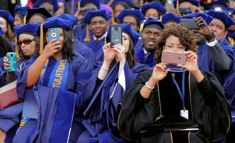 FILE PHOTO: Students photograph U.S. President Barack Obama with their phones as he delivers the commencement address to the 2016 graduating class of Howard University in Washington