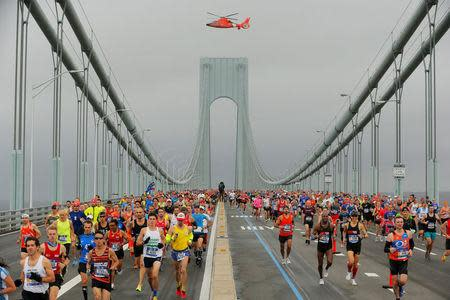 The first wave of runners make their way across the Verrazano-Narrows Bridge during the start of the New York City Marathon in New York, U.S., November 5, 2017. REUTERS/Lucas Jackson