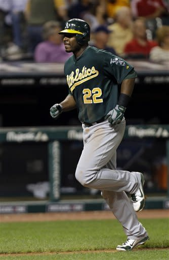 Oakland Athletics' Chris Carter trots home after a solo home run off Cleveland Indians starting pitcher Zach McAllister in the fifth inning of a baseball game Tuesday, Aug. 28, 2012, in Cleveland. (AP Photo/Mark Duncan)
