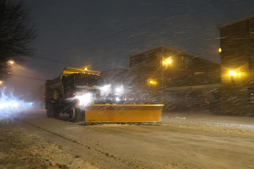 <p>Plows do their best to clear the mess overnight Wednesday in Cliffside Park, New Jersey.</p>