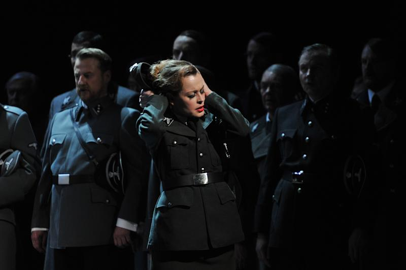 "The photo provided by Deutsche Oper am Rhein in Duesseldorf, western Germany, shows Elena Zhidkova as Venus in front of the choir in a scene of the the opera 'Tannhaeuser' during the dress rehearsal on April 30, 2013. The modern production of Richard Wagner's opera Tannhauser has caused a stir in Germany because of Nazi-themed scenes showing people dying in gas chambers and a family getting their heads shaved and executed. A spokeswoman for the Duesseldorf opera house said Tuesday that members of the audience ""booed and were shocked"" by Saturday's, May 3, 2013 opening performance. (AP Photo/Deutsche Oper am Rhein, Hans Joerg Michel) Mandatory Credit"