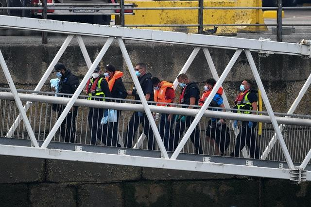 A group of people, thought to be migrants, disembarking
