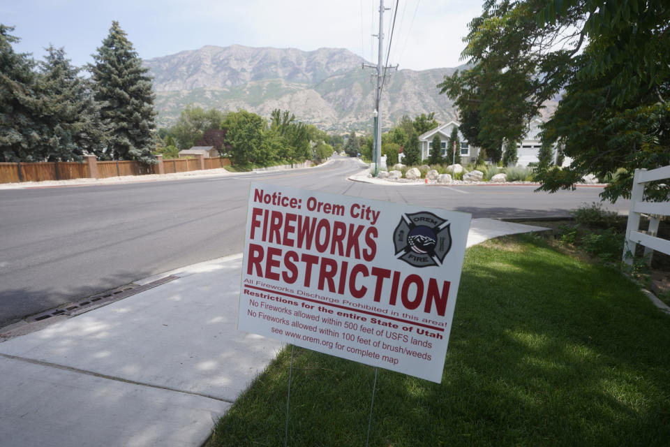 """A """"Orem City Fireworks Restriction"""" sign is shown on Tuesday, June 22, 2021, in Orem, Utah. Many Americans aching for normalcy as pandemic restrictions end are looking forward to traditional Fourth of July fireworks. But with a historic drought in the U.S. West and fears of another devastating wildfire season, officials are canceling displays, passing bans or begging for caution. (AP Photo/Rick Bowmer)"""