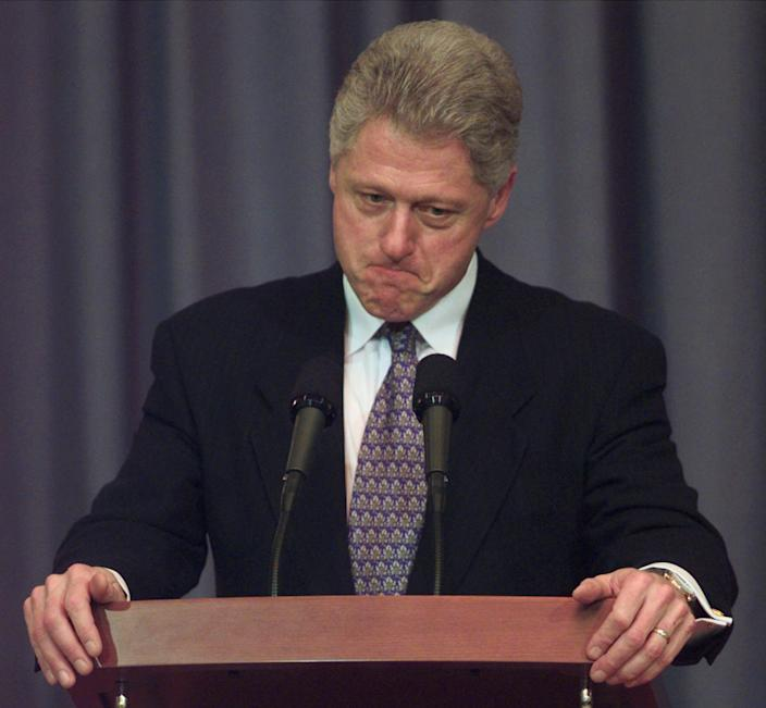 President Bill Clinton ponders a question about the impeachment hearings in 1998. (Photo: Susan Walsh/AP)