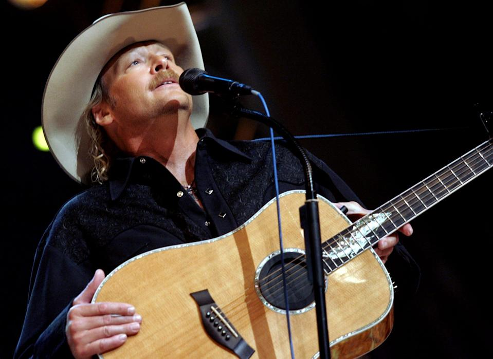 Alan Jackson performs during the Country Reaches Out, an Grand Ole Opry Benefit for the American Red Cross at the Opry House Sept. 27, 2005.