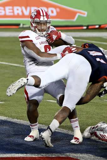 Louisiana-Lafayette running back Trey Ragas (9 scores the go-ahead touchdown as UTSA linebacker De'Marco Guidry (41) goes for the tackle during the fourth quarter of the First Responder Bowl NCAA college football game in Dallas, Saturday, Dec. 26, 2020. (AP Photo/Matt Strasen)