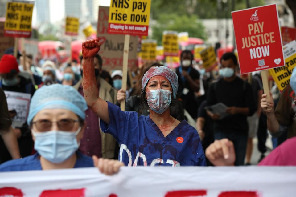 NHS workers march to Downing Street, London, during a rally to demand the government give them a 15 per cent pay rise.